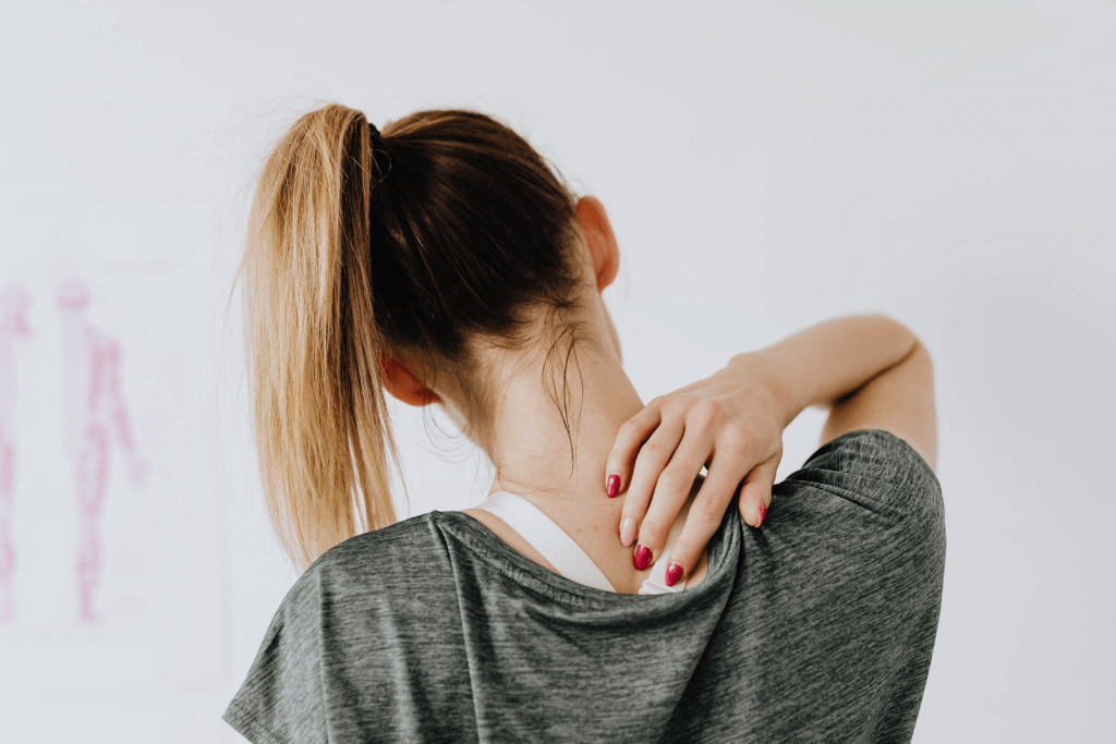 female with shoulder blade pain and headaches