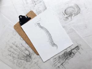 piece of paper with lumbar spine and disc herniations